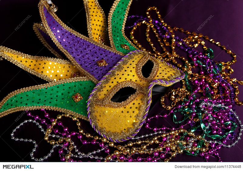 Mardi Gras Mask And Beads On A Purple Background