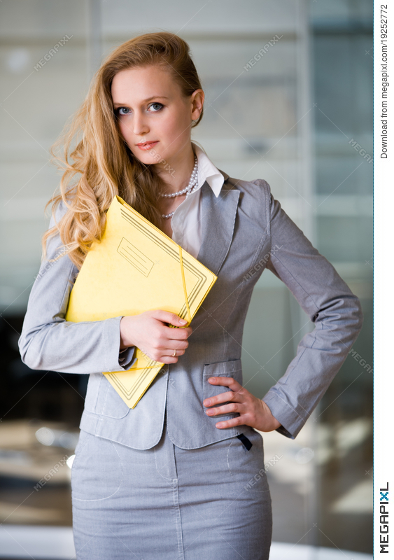 Beautiful Secretary In The Office Stock Photo 19252772 - Megapixl
