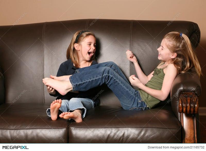 children tickling feet stock photo 21165732 megapixl