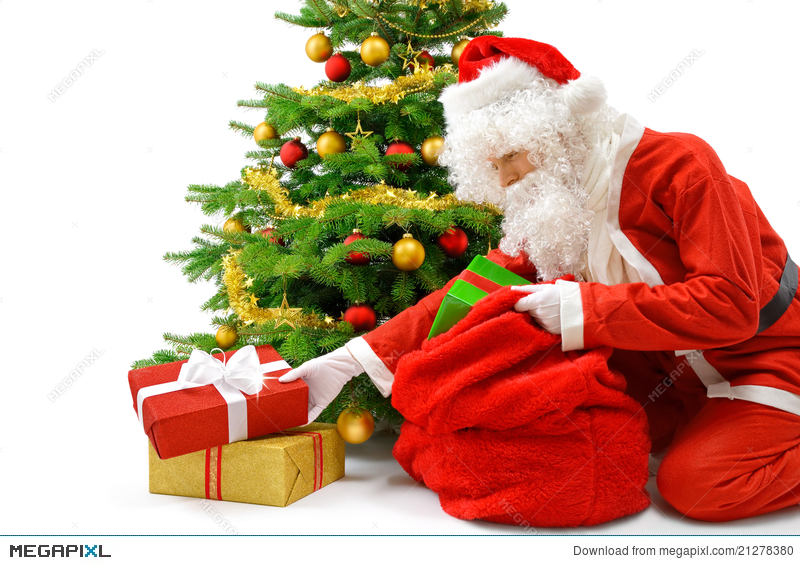 Santa Putting Gifts Under The Christmas Tree