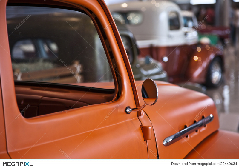 Old Orange Pickup Truck Car Sideview Mirror