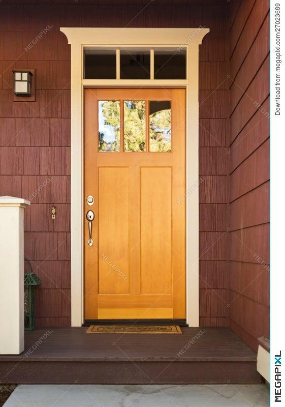 Light Wood Front Door On A Home