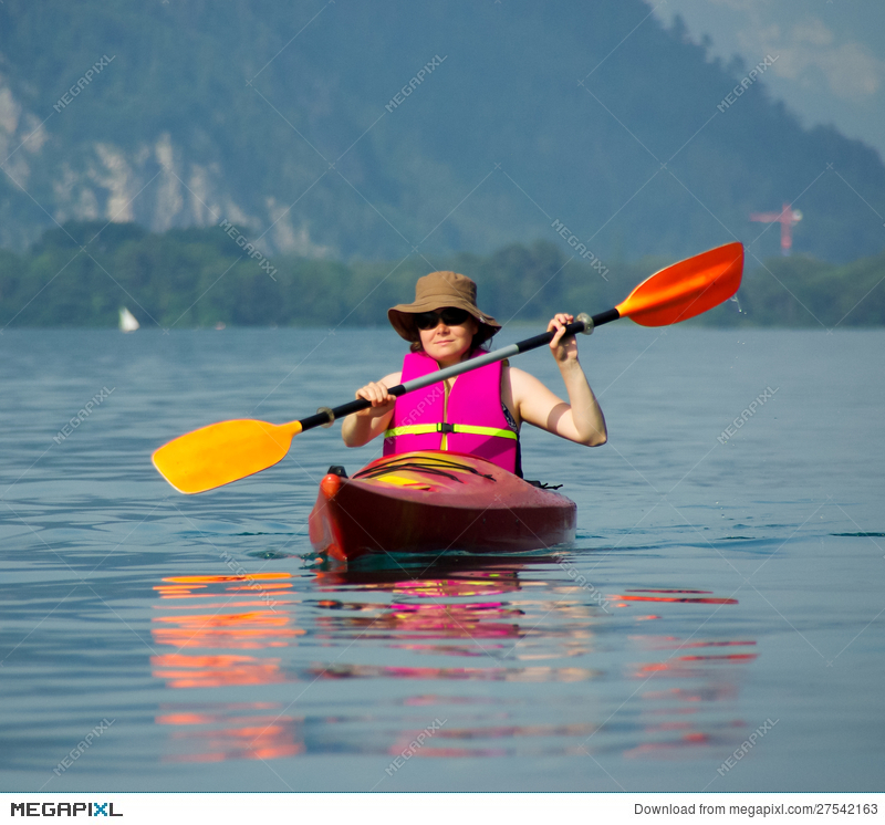 4107f933ed Woman Rowing In Kayak Stock Photo 27542163 - Megapixl