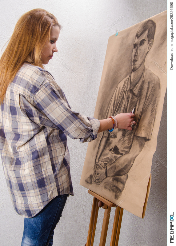 young female artist drawing man portrait art studio stock photo