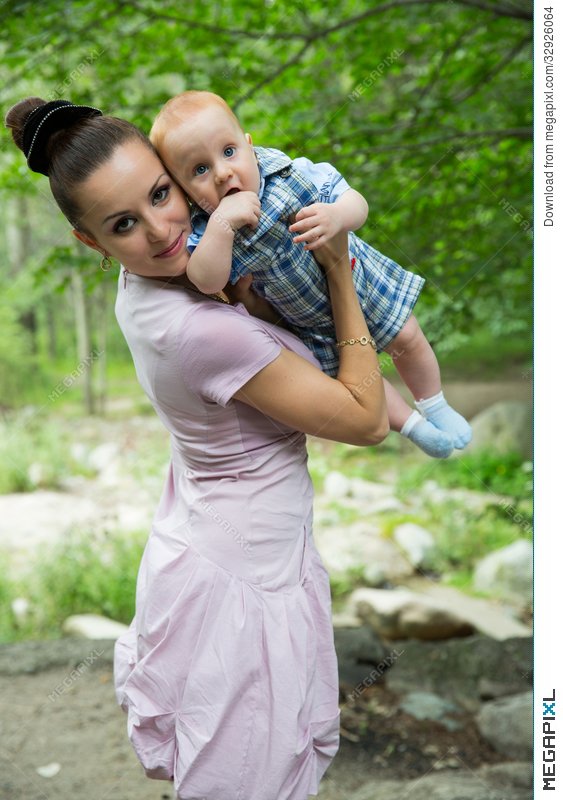 Happy Mom And Baby Boy Hugging And Laughing Beautiful Mother And