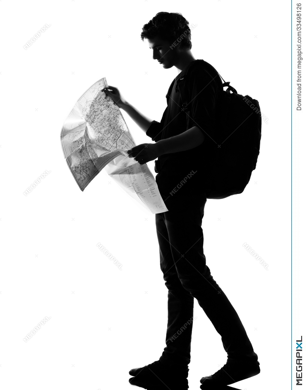 Young Man Silhouette Backpacker Reading Map Stock Photo - Map silhouette