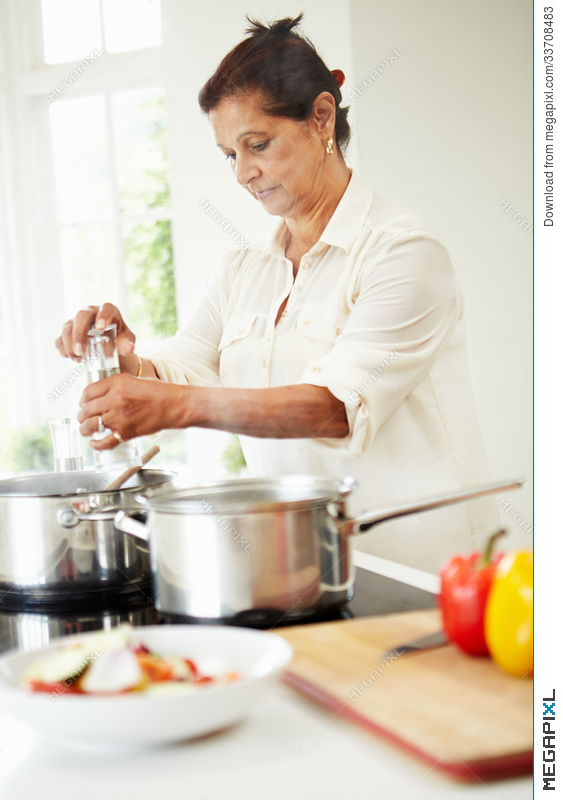 Senior Indian Woman Cooking Meal At Home Stock Photo 33708483 Megapixl