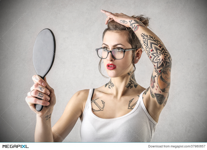 woman holding hand mirror. Young Tough Woman With Tattoos Holding A Mirror Hand U