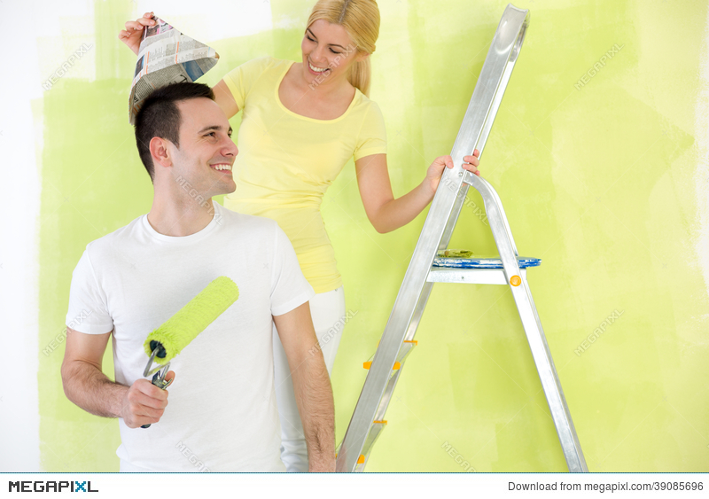 Laughing Couple Painting Together