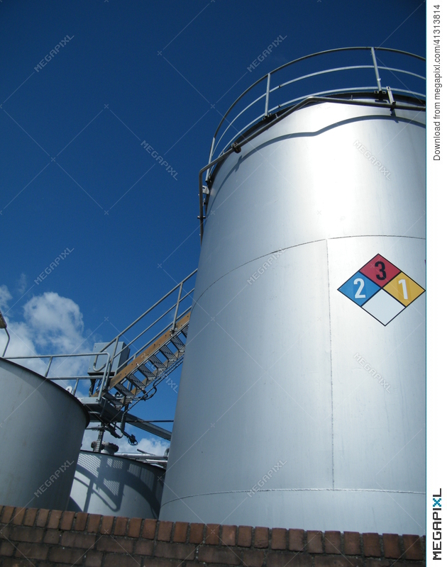 Industrial Storage Tanks For Chemicals With Safety Sign
