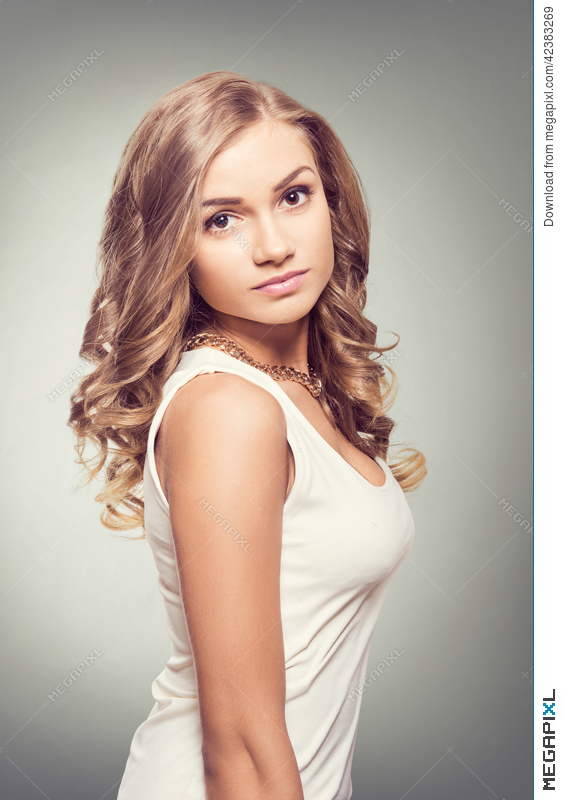 Cute Blonde Woman With Brown Eyes And Long Curly Hairs Stock