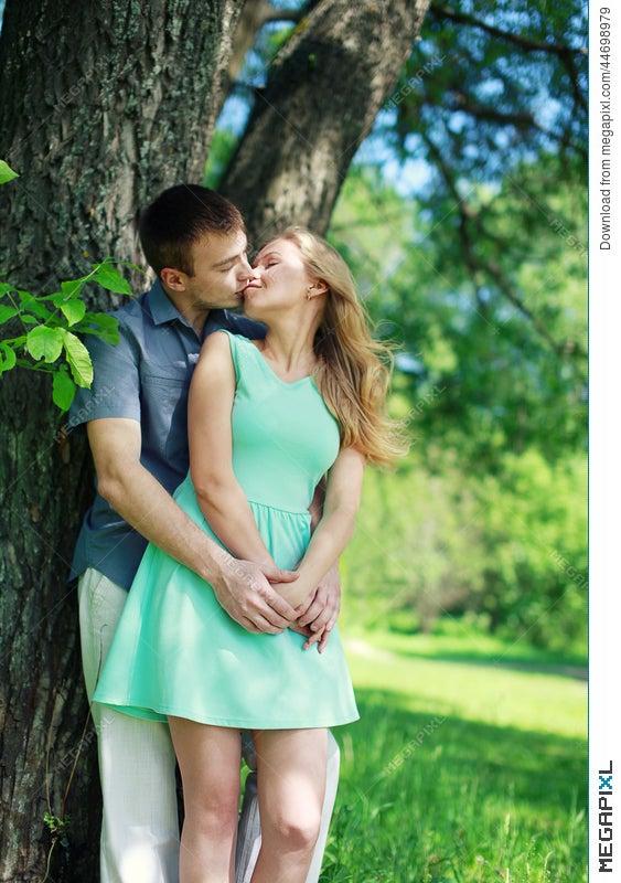 lovely sensual couple in love enjoying kiss outdoors stock photo