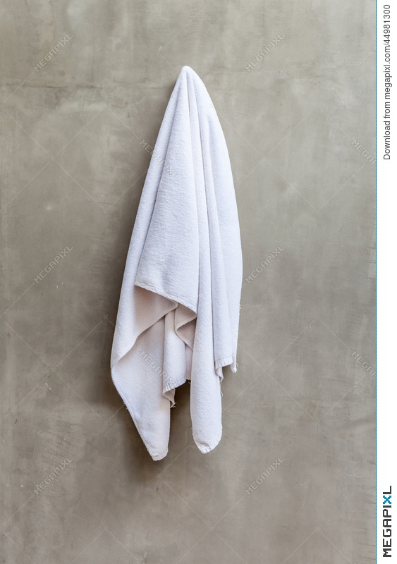 hanging white towel. White Towel Is Hanging On The Exposed Concrete Wall In Bathr