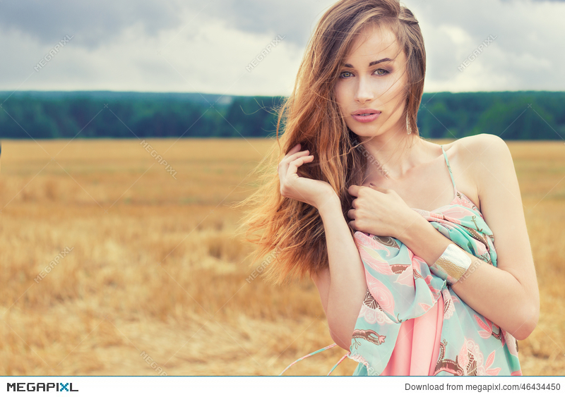 75a8431067b8 Beautiful Romantic Girl With Red Hair Wearing A Colored Dress