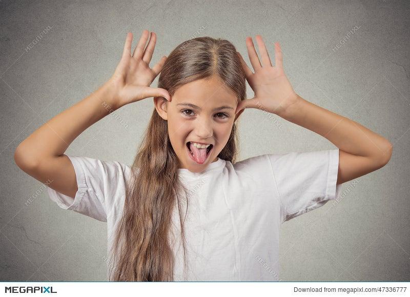 Teenager Girl Sticking Out Tongue Mocking Someone Stock Photo