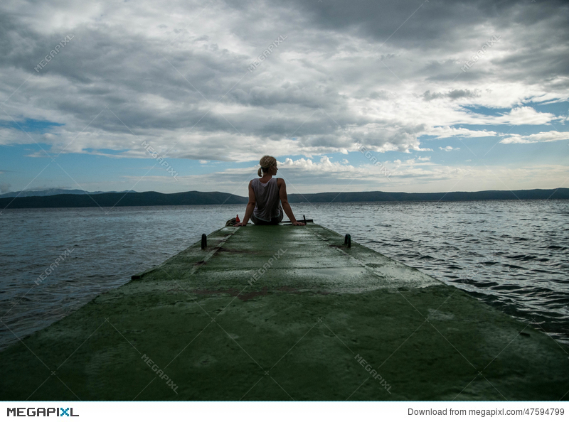 Depressed Woman Young Girl Depression Stress And Problems Pain Female Depressed Young Woman Sitting On Pier Looking Over Horizon Stock Photo 47594799 Megapixl