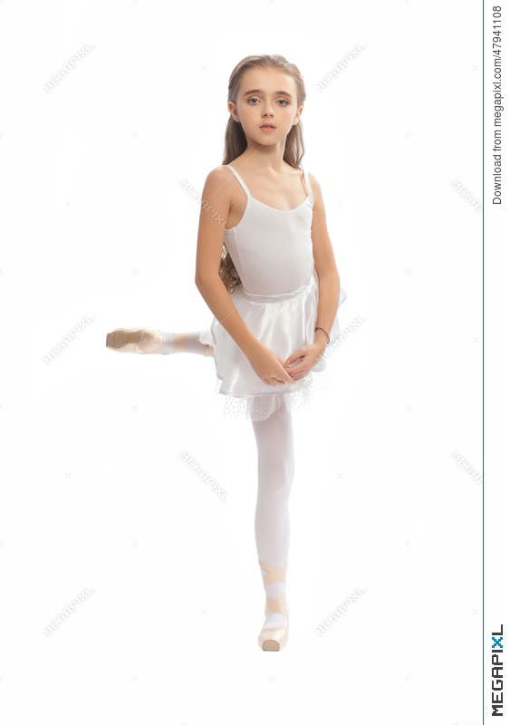 c0abe1072e04 Stock Photo: Young Girl In Her Dance Clothes Reaching Down To Touch Her  Foot.