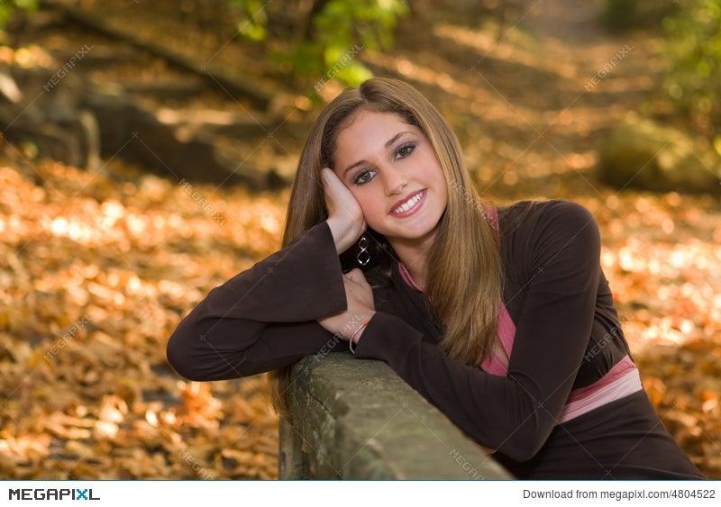13 year old teen girl in fall foliage.