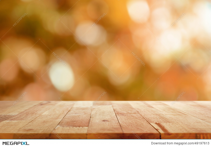Wood table top on brown bokeh abstract background. Wood Table Top On Brown Bokeh Abstract Background Stock Photo