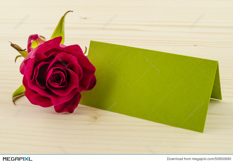 Rose Flower With Blank Invitation Card On Wooden Background