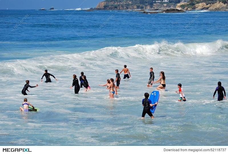 Children Playing In The Surf Of Sleepy Hollow Beach Laguna California