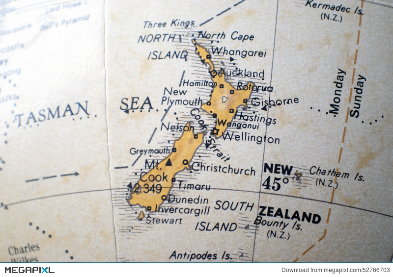 Map of new zealand on a world globe stock photo 52766703 megapixl map of new zealand on a world globe gumiabroncs Image collections