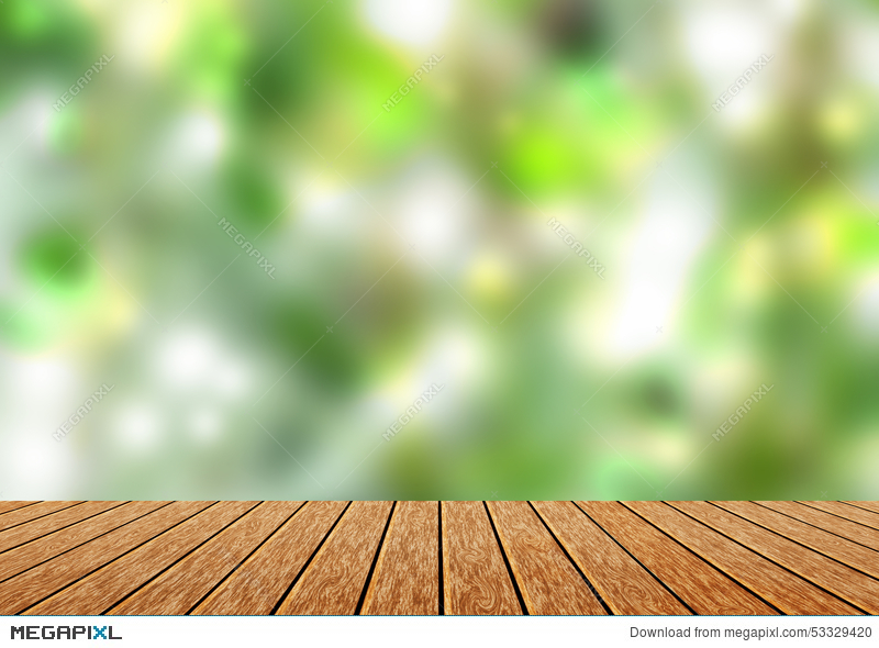 Wood table top with blur green nature bokeh background. Wood Table Top With Blur Green Nature Bokeh Background