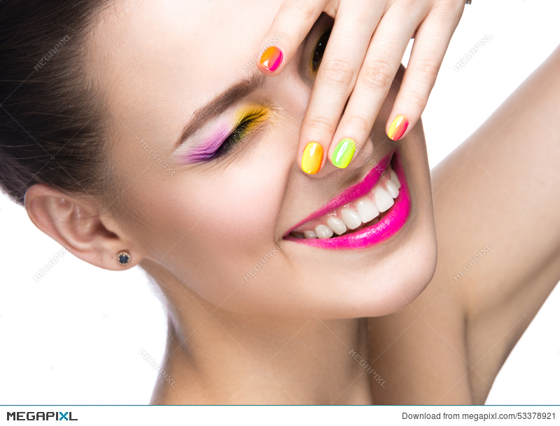 Beautiful Model Girl With Bright Colored Makeup And Nail Polish In ...