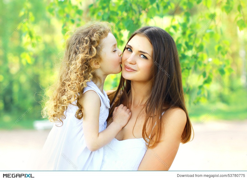 loving daughter kissing mother happy young mom and child in warm