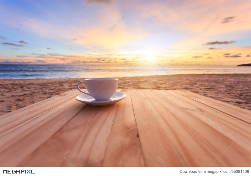 Coffee cup on wood table at sunset or sunrise beach & Coffee Cup On Wood Table At Sunset Or Sunrise Beach Stock Photo ...