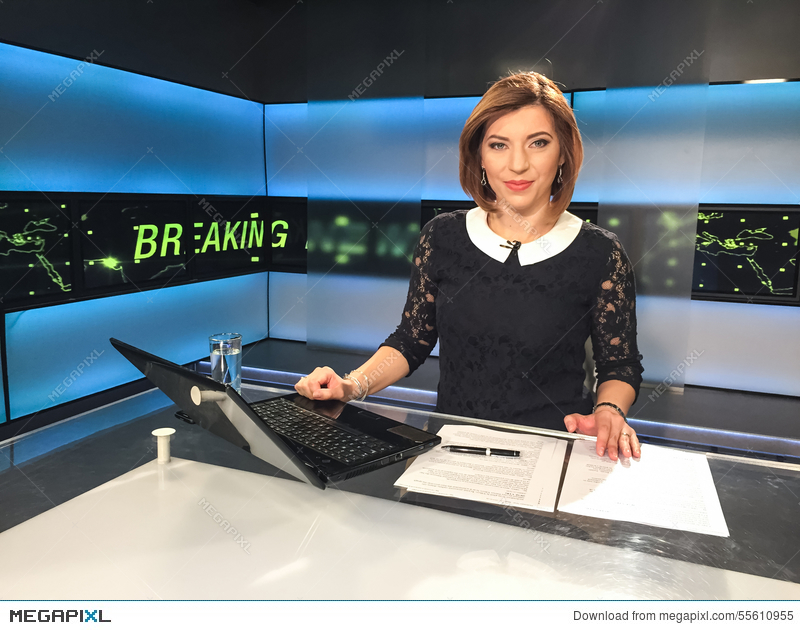 TV Reporter At The News Desk