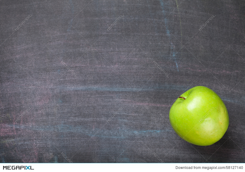 Green Apple On Blackboard Or Chalkboard Background