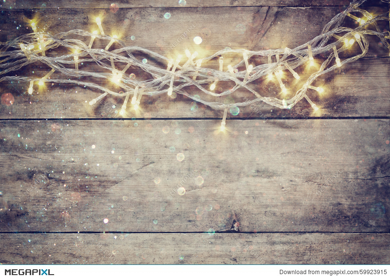 Christmas Warm Gold Garland Lights On Wooden Rustic Background Filtered Image With Glitter Overlay