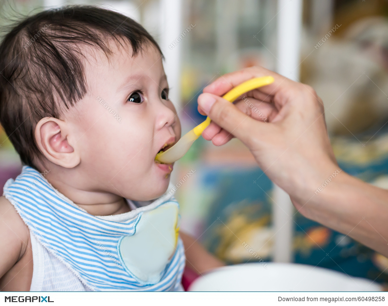 12777b5068a Asian Baby 6 Months Old Eating Food From Spoon. Stock Photo 60498258 ...