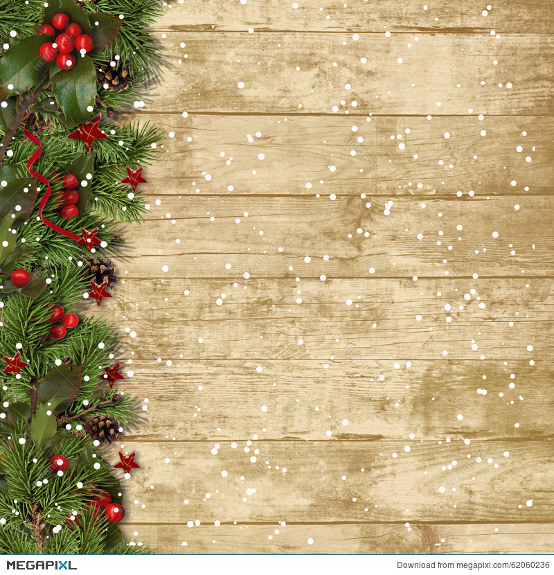 Christmas Fir Branches And Holly On Wood Background