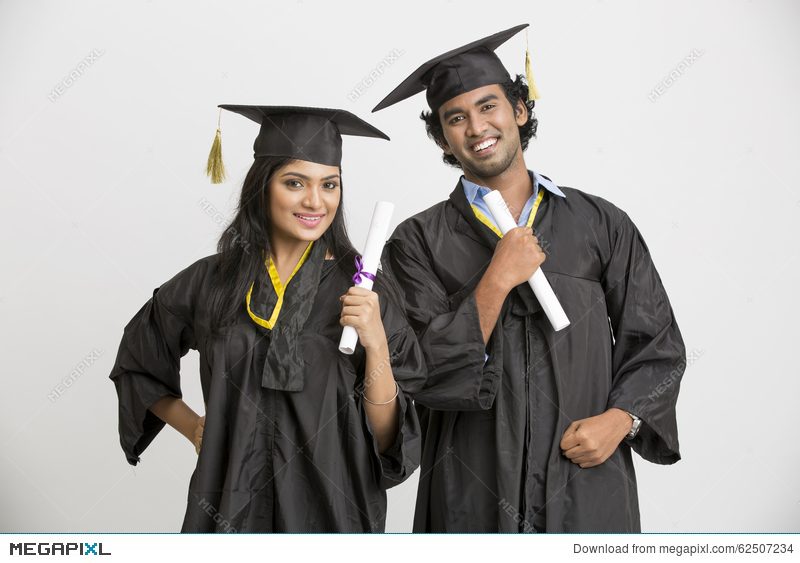 Happy Smiling Indian College Graduates Wearing Cap And Gown Holding ...