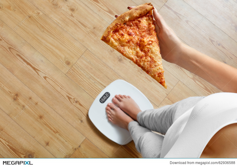 diet fast food woman on scale holding pizza obesity stock photo
