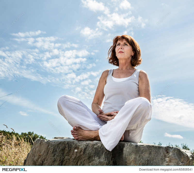 Breathing Outdoors For Beautiful Middle Aged Yoga Woman