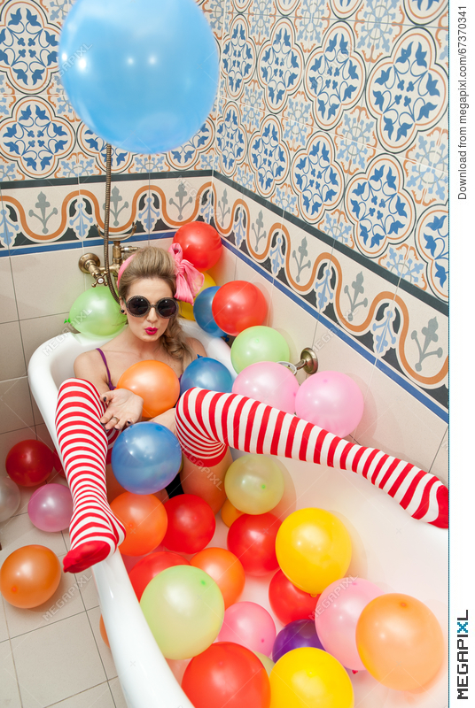 Blonde Woman With Sunglasses Playing In Her Bath Tube With Bright