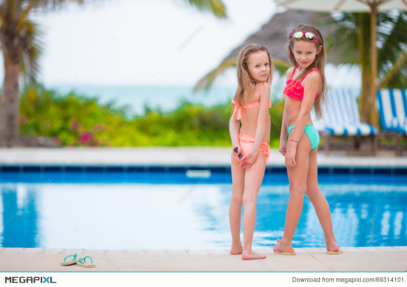 Adorable Little Girls Having Fun In Outdoor Swimming Pool On